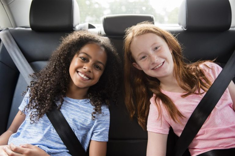 Portrait of smiling girls in car